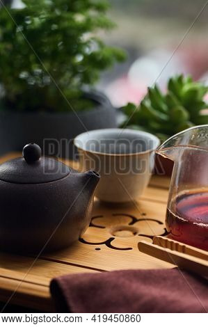 Tea Ceremony Gong Fu Cha. Handmade Purple Yixing Zisha Clay Chinese Teapot With Shu Pu Erh And Celad