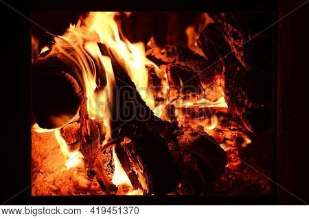 Fire Or Flames With Sparks In Fireplace Close Up. 4k Resolution. Fire Is Burning In The Fireplace