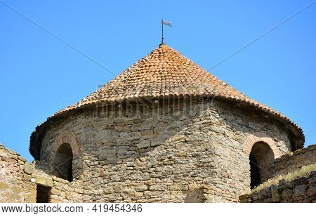 A Tower Of A Medieval Fortress With Limestone Thick Walls And Reconstructed Wooden Roof. A Tower Of