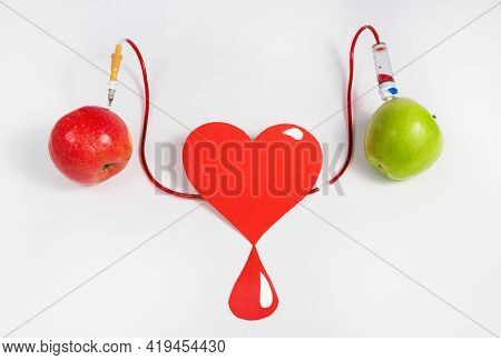 Two Apples And A Heart As A Symbol Of The Donor's Mercy To A Recipient Or A Sick Person. Blood Trans