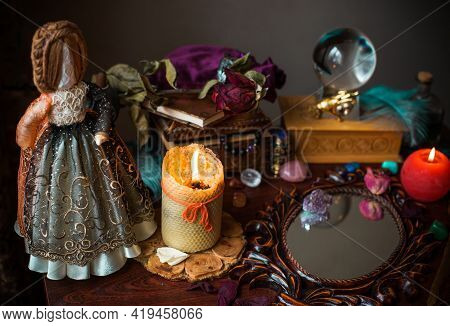 A Fortune Teller, Witch Stuff On A Table, Candles And Fortune-telling Objects. The Concept Of Divina