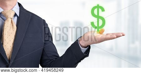 Businessman Showing Dollar Sign. Male Business Manager Is Offering Big Green Dollar Symbol In His Ha