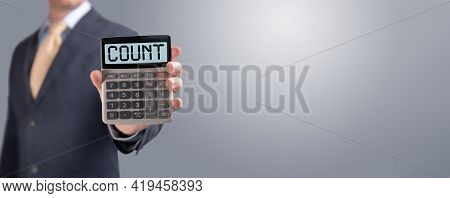 Businessman Shows Calculator With Word Count On Screen. Growth And Progress, Investment In Finance A