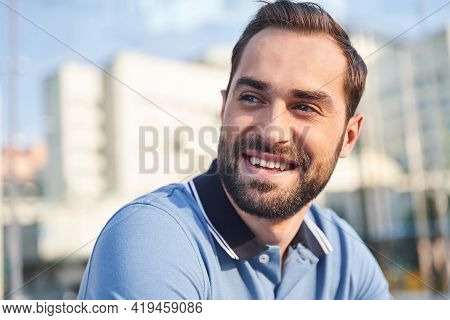Jolly Young Man Spending Sunny Day Outdoors