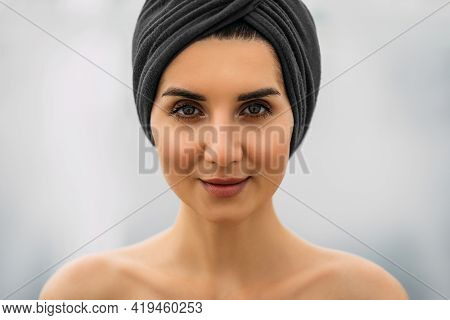 Portrait Of A Beautiful Girl With A Turban On Her Head. Pretty Close-up Face Of A Fashionable Woman.