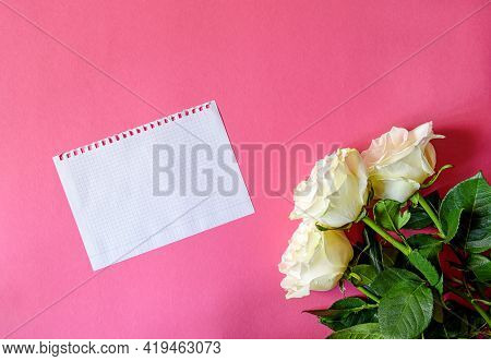 Postcard With Three White Roses On A Pink Background With Hearts. Greeting Card With The Concept Of
