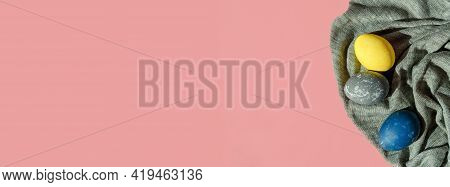 Fabric Banner With Colorful Easter Eggs In Pastel Colors On A Pink Background. Happy Easter Card Con