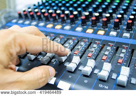 Hands Of Men Are Controlling The Console Of A Large Hi-fi System. Sound Equipment. Control Panel Of