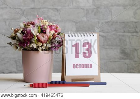 October 13. 13-th Day Of The Month, Calendar Date.a Delicate Bouquet Of Flowers In A Pink Vase, Two