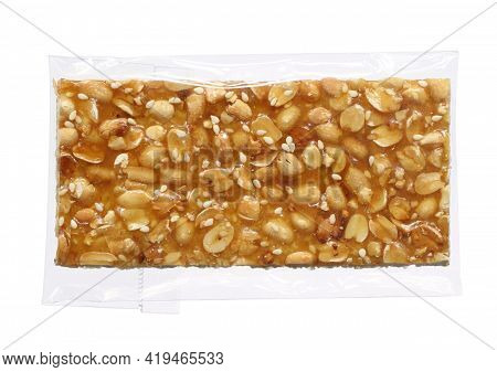 Sweet Peanut And Sesame Candy Strips In Wrap (with Clipping Path) Isolated On White Background