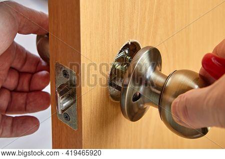 Door Handles With Latch And Lock Are Installed In New Interior Door, Ball-shaped Doorknob In Bronze