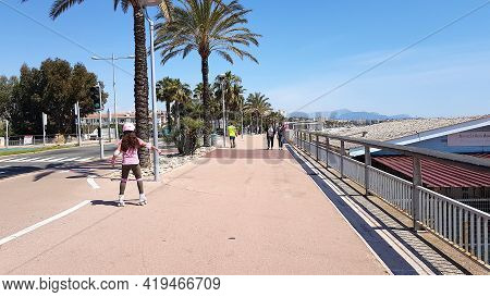 Cagnes-sur-mer, France - 25 April, 2021: People Walking In The Street In The Front Of The Sea. The C