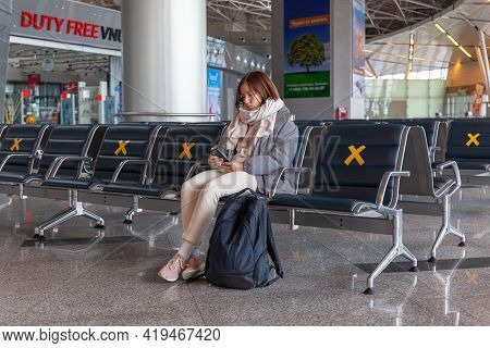 Girl Tourist With Backpack Waiting For Flight In Airport, Horizontal, Russia Moscow Vnukovo 2021-03-