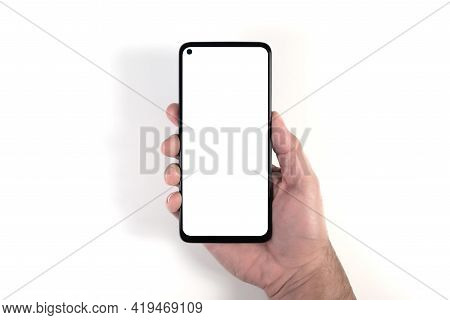 Hand Holding Smartphone With Blank White Screen Against White Background, Person Using Smartphone Te