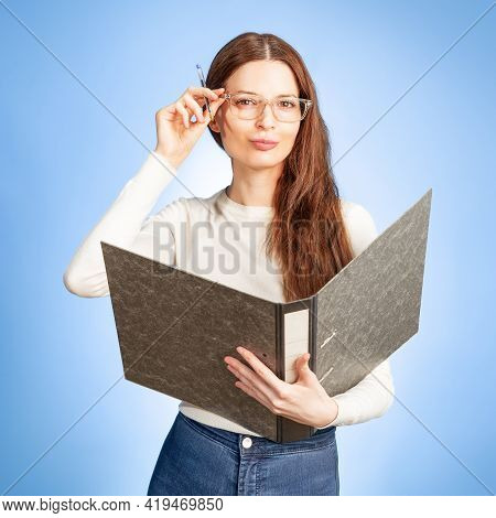 Young Secretary With A Folder In Her Hand