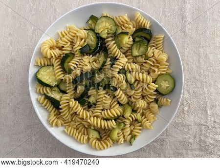 Italian Fusilli Pasta With Zucchini And Olive Oil In A White Dish. Vegetarian And Vegan Food.