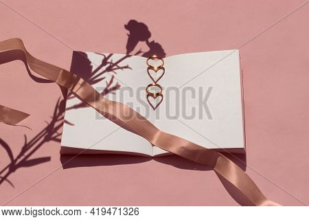 Summer Wedding Mockup. Blank Wedding Book With A Flowers. Wedding Rings Are Placed On The Book And T
