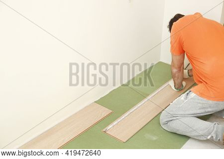 Installation Laminate Or Parquet In The Room, Worker Installing Wooden Laminate Flooring, Marking Th