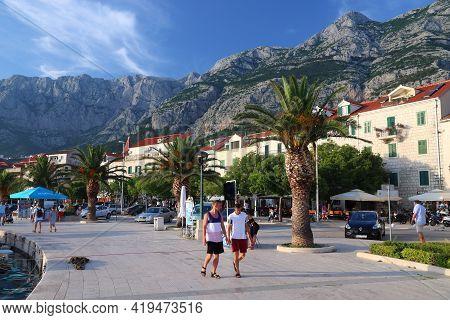 Makarska, Croatia - June 21, 2019: People Visit The Harbor Promenade In Makarska, Croatia. Croatia H