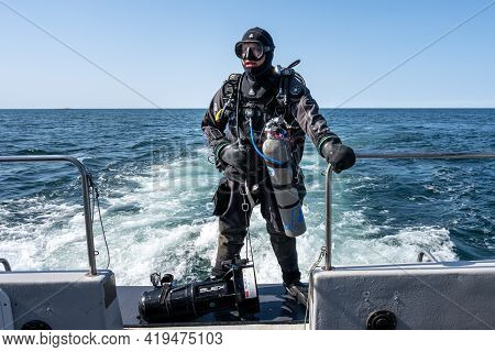 April 17, 2021 - Hamburgsund, Sweden: A Scuba Diver Waiting For The Dive Boat To Get Into Position S