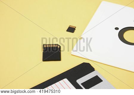 Various Types Of Disks For Storing Information On A Yellow Background, Modern Flash Cards And Retro