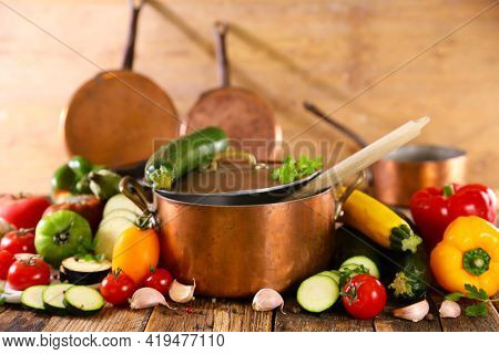 casserole with vegetables on wood background