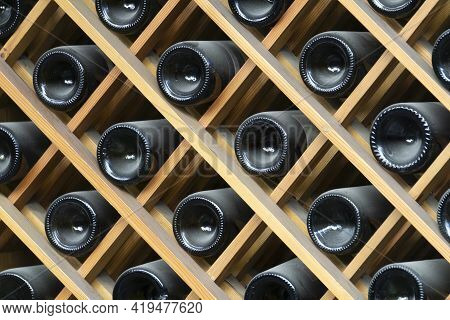 Wine Bottles Background. Bottles Of Red And White Wine In A Wine Cabinet Of A Liquor Store. High Qua