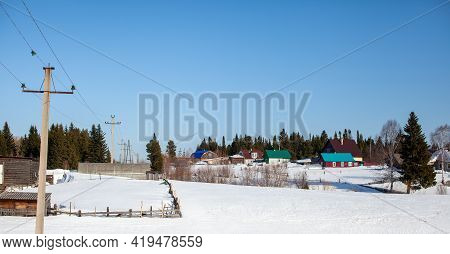 Lots Of Snow After A Snow Storm In Winter. Houses In The Snow Captivity. The Wooden Fence Near The H