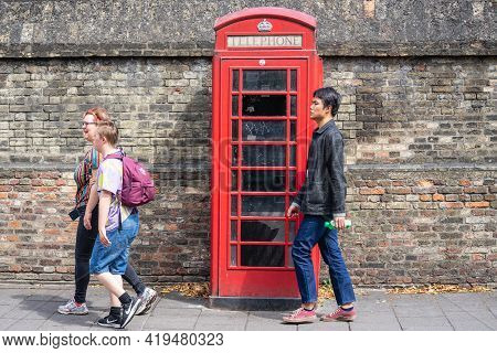 Red Telephone Box, A Telephone Kiosk For A Public Telephone Is A Familiar Sight On The Streets Of Th