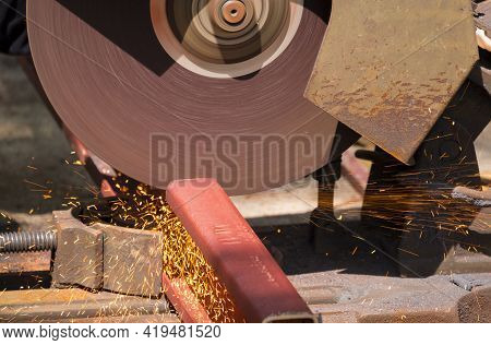 Close Up Image Of The Old Circular Grinder Cutting Red Lip Channel Steel In Construction Site