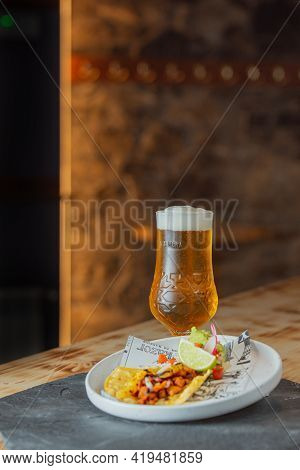 Arinsal, Andorra : 2021 April 29 : Beer Accompanied By A Taco Al Pastor. Typical Mexican Food