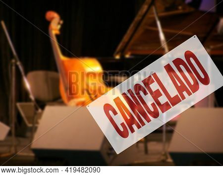 Spanish Inscription Canceled. Sign Warning Of Jazz Music Festival Is Cancelled Due To Coronavirus In