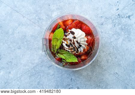 Delicious Italian Dessert Panna Cotta With Strawerry Sauce, Meringue And Fresh Mint Leaves.