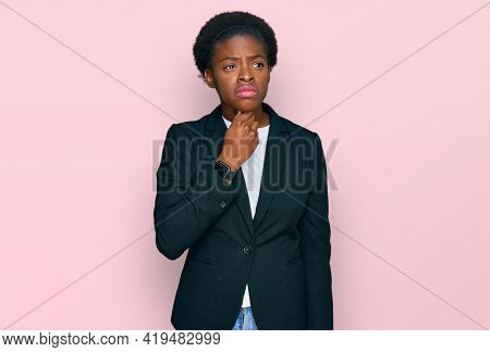 Young african american girl wearing business clothes touching painful neck, sore throat for flu, clod and infection