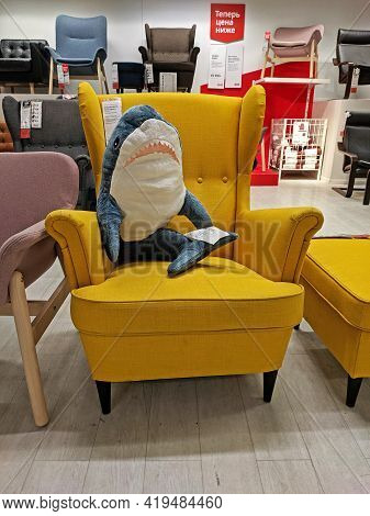 Moscow, Russia - March 07, 2020: A Soft Shark Toy Sits In A Yellow Armchair In The Ikea Store In Mos