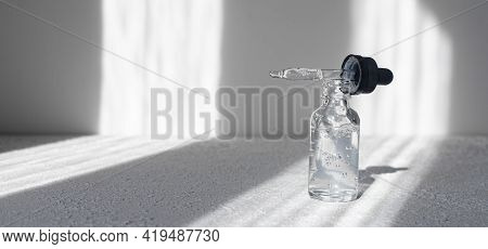 Hyaluronic Acid In A Bottle On A White Background . Cosmetology. Cosmetology Bottles.spa. Spa Treatm