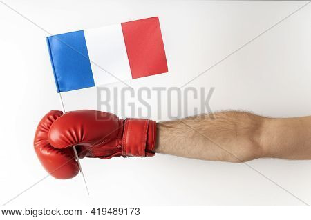 Boxing Glove With French Flag. Boxer Holds Flag Of French . White Background.