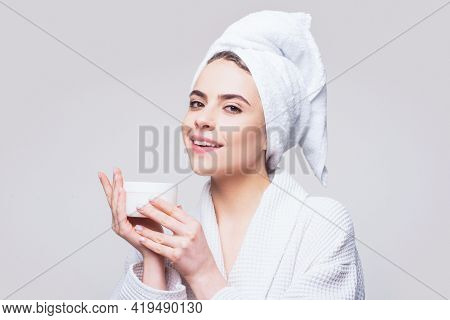 Cosmetic Skincare Product. Face Beauty Care. Portrait Of Beautiful Woman With Facial Cream In Hand.