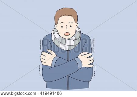 Feeling Cold And Frozen Concept. Young Man In Warm Coat And Scarf Standing Feeling Cold With Surpris