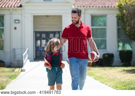 Father Supports And Motivates Son. Kid Going To Primary School. Teachers Day.