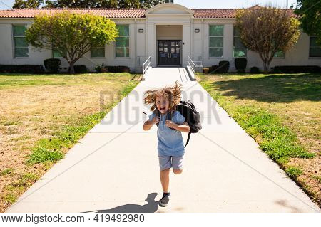 Back To School. Dynamic Images That Go Back To The Conceptual School. Cute Kid With Backpack Running