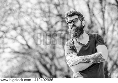Bearded Man Wear Modern Fashionable Sunglasses. Uv Filter. Man Bearded With Sunglasses Nature Backgr