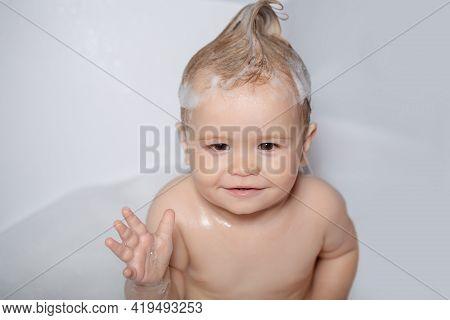 Funny Todler In Shower. Kid In Bathtub With Fluffy Soap Bubble. Cute Baby Boy Enjoying Bath And Bath