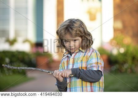 Child Aggression. Negative Kids Emotion. Angry Boy With Stick. Kid Adaptation. Bully. Bullying Conce