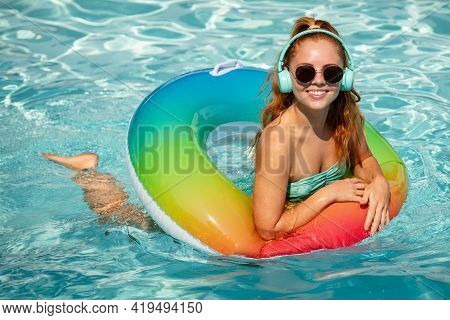Woman On Swim Ring. Summer Mood Concept. Pool Resort. Summertime Days. Vacation, Summer Holiday.