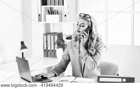 Female Business Leader. Woman Sit At Her Desk In Office. Business Woman Working In Office With Docum