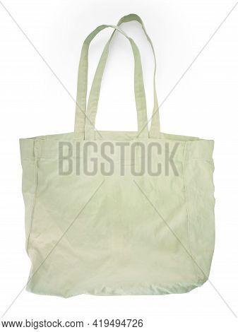 Close Up Of White Canvas Tote. Cotton Cloth Bag Isolated On White Background. Front View Of Blank Sh