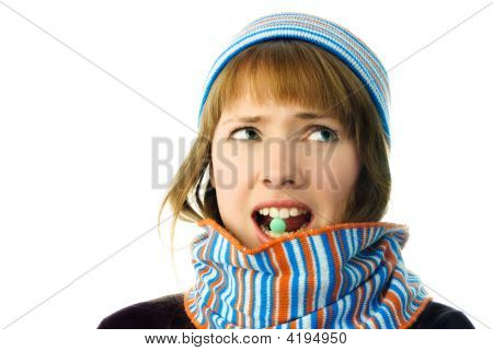 Beautiful Girl With A Tablet In Her Mouth