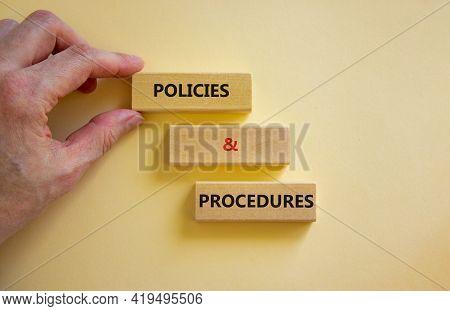 Policies And Procedures Symbol. Wooden Blocks With Words 'policies And Procedures' On White Backgrou