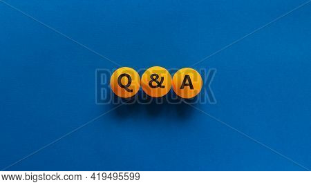 Q And A, Questions And Answers Symbol. Concept Words 'q And A, Questions And Answers' On Orange Tabl